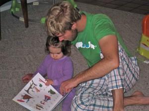 Joel reading Evie a book