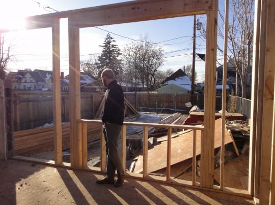 Work inside - Joel standing by the frame of the back bedroom window