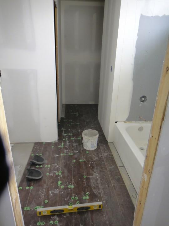 Work inside - tiling the upstairs bathroom