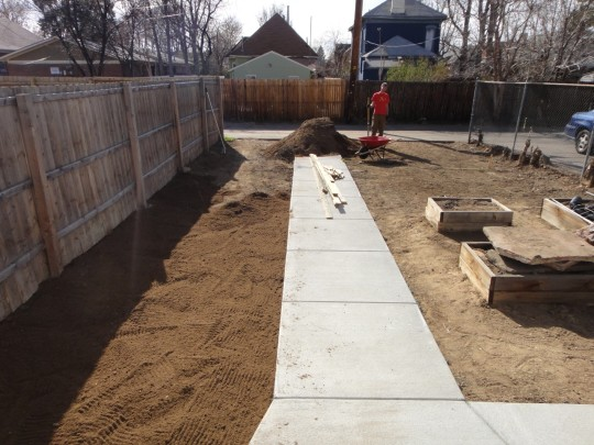 The walk is poured, and Joel and I spread several yards of topsoil
