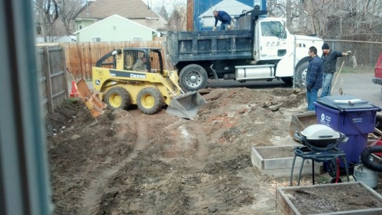 The more legit guys finishing up the concrete removal and grading the yard